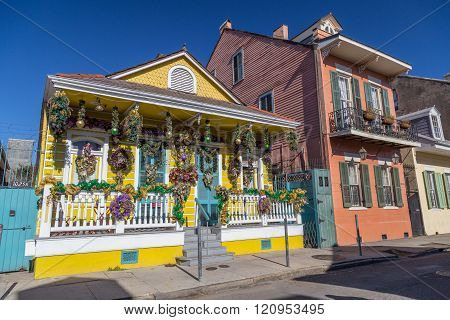 Old Colonial Houses On The Streets Of French Quarter Decorated For Mardi Gras In New Orleans,  Louis