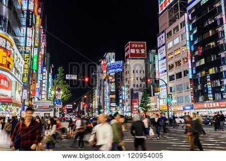 People Walking Along The Streets Of Shinjuku Shopping At Night.