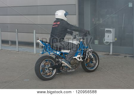 Stuntman riding a motorcycle before starting  stunt show