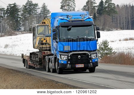 Blue Renault Trucks T Hauls Construction Equipment