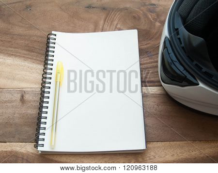 White Helmet And White Book On Old Wood Table