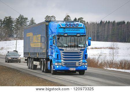 Blue Scania Hauls Curtainsider Cargo Trailer