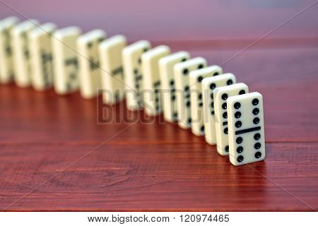 Dominoes on a wooden background