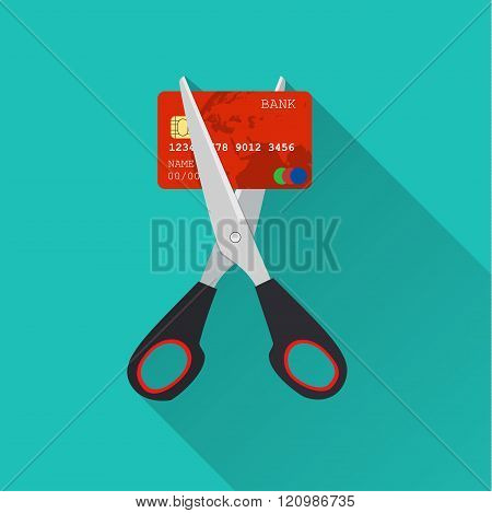 Red credit card cutting by the scissors.