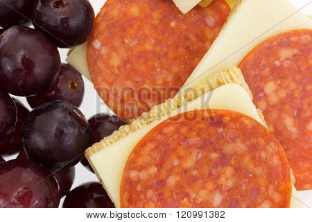 Pepperoni And Cheddar Cheese Crackers With Grapes