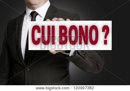 Cui Bono Sign Is Held By Businessman Background
