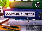 Commercial Offer - Blue Office Folder on Background of Working Table with Stationery and Laptop. Commercial Offer Business Concept on Blurred Background. Commercial Offer Toned Image. 3D. poster