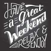 Have a great weekend relax and enjoy. Hand lettering and calligraphy inspirational quote isolated on blackboard background with chalk poster