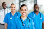 pretty medical nurse and colleagues in hospital poster