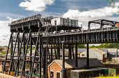 Upper trough of the Anderton Boat Lift which raises narrowboats between River Weaver the Trent and Mersey Canal. England United Kingdom. poster