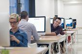 startup business, software developer working on desktop  computer at modern office poster