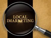 Local IMarketing Concept through Magnifier on Old Paper with Black Vertical Line Background. 3D Render. poster