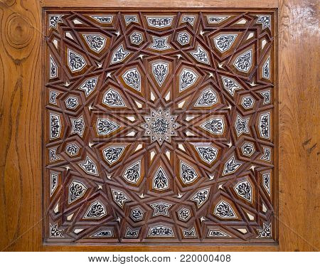 Closeup of arabesque ornaments of an old aged decorated wooden door, Old Cairo, Egypt