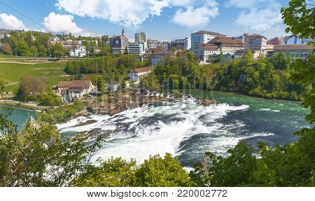 Rhein Waterfall, Germany - April 2017:  Power of nature at Rhein Waterfall. View on a sunny day