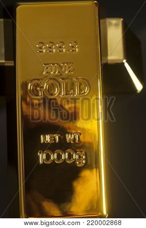 Gold bullion ingot on a black background