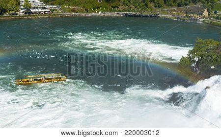 Rhein Waterfall, Germany - April 2017: tourists on a boat cruise at Rhein waterfall