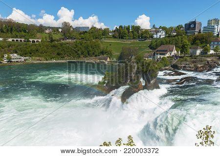 Rhein Waterfall, Germany - April 2017:  Powerful stream of Rhein Waterfall