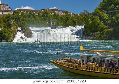 Rhein Waterfalls, Germany - April 2017: touristic boat cruise at Rhein waterfalls