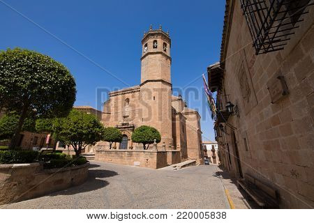 landmark street and bell tower of church of San Mateo or St Matthew, gothic and renaissance from Fifteenth century, in old town of Banos de la Encina, Jaen, Andalusia, Spain Europe