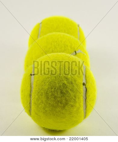 Line of tennis balls. isolated on white