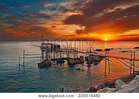 Rocca San Giovanni, Chieti, Abruzzo, Italy: Adriatic sea coast at dawn with an ancient fishing hut trabocco, the typical mediterranean wooden pilework