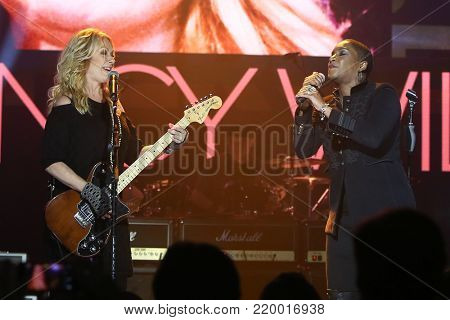 NEW YORK - NOV 29: Musician Nancy Wilson (L) and Liv Warfield perform at America Salutes You & Wall Street Rocks Presents Guitar Legends For Heroes at Terminal 5 on November 29, 2017 in New York City.