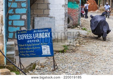 POKHARA, NEPAL - September 29, 2013: Laundry advertising on the street in the mountain village in Pokhara. Pokhara is the starting point for most of the treks in the Annapurna area.