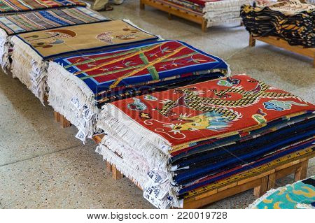 POKHARA, NEPAL - September 30, 2013: Shop with hand-woven carpets in Tashi Ling village. Tashi Ling is one of the Tibetan refugee camps in Nepal
