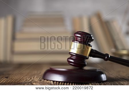 Law concept. Mallet of the judge on rustic wooden table. Place for text.