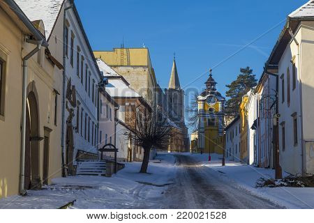 Ancient Spisska Kapitula, central street ( known as Slovak Vatican ) on background blue sky at winter. Spisske Podhradie, Slovakia, UNESCO World Heritage Site. Tourist attraction