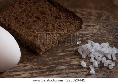 piece of coarse rye bread with salt and egg traditional food of ordinary people in the olden days