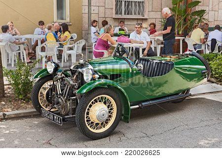 SAN PATRIZIO, RA, ITALY - AUGUST 25: british three wheeler car Morgan MX4 (1934)in classic car and motorcycle rally Motoraduno d'Epoca, on August 25, 2013 in San Patrizio, RA, Italy