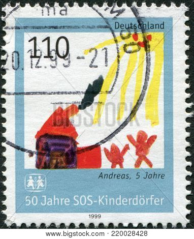 GERMANY - CIRCA 1999: A stamp printed in the Germany, is devoted to 50 anniversary of SOS Children's Village, a child's drawing,