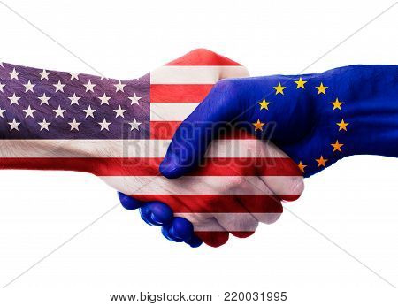United States and European Union bilateral political relations and cooperation concept with USA and EU flags painted on handshake.