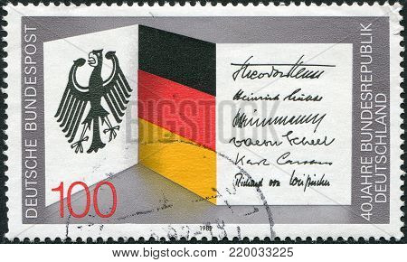 GERMANY - CIRCA 1989: A stamp printed in Germany, dedicated to 40th anniversary of the Federal Republic of Germany, shows the national flag, national coat of arms and signatures of presidents, circa 1989