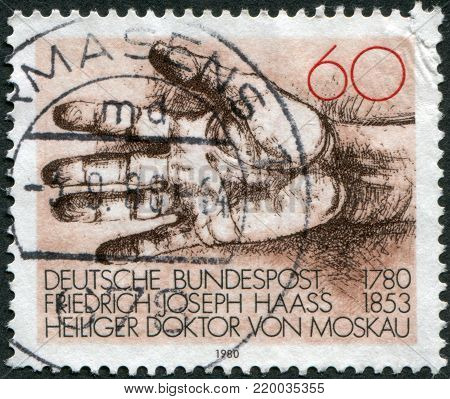GERMANY - CIRCA 1980: A stamp printed in Germany, dedicated to the 200th anniversary of the birth Dr. Friedrich Joseph Haass (1780-1853), physician and philanthropist, depicted Helping Hand, circa 1980