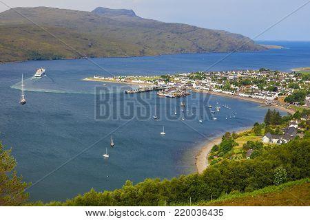 Ullapool, Scottish Highlands, Scotland, United Kingdom. Quaint Village And Loch Broom, Beneath Mountain Range