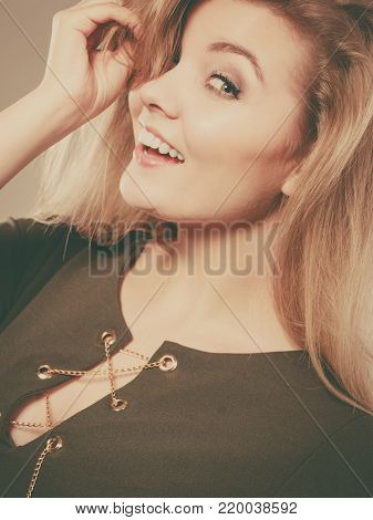 Fashionable outfit ideas, trendy clothes concept. Attractive blonde woman wearing tight dark green khaki top