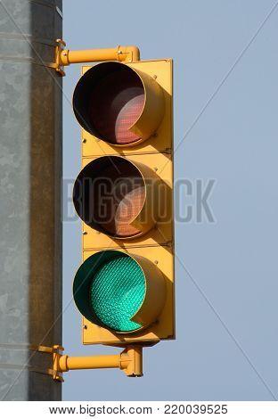 Green light illuminated on stop and go traffic light signal