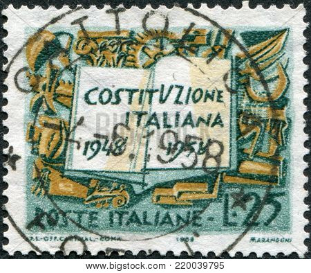 ITALY - CIRCA 1958: A stamp printed in Italy, is dedicated to the 10th anniversary of the Constitution shows Book and Symbols of Labor Industry and Agriculture, circa 1958