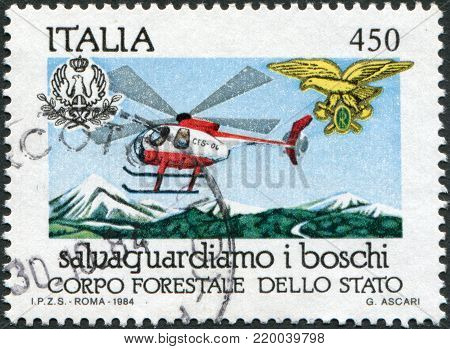 ITALY - CIRCA 1984: A stamp printed in Italy, is dedicated to Forest Preservation, shows Helicopter fire patrol, circa 1984