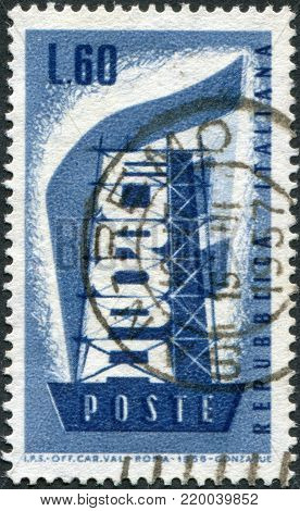 ITALY - CIRCA 1956: A stamp printed in Italy, shows a character Rebuilding Europe, circa 1956