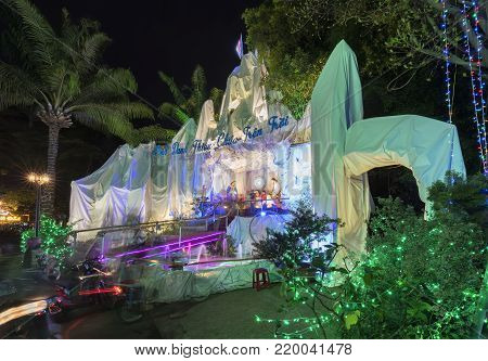 Ho Chi Minh City, Vietnam - December 27, 2017: Night view model crib scene reconstruction Jesus was born with many sparkling lights to attract visitors to reverence God church in Ho Chi Minh, Vietnam
