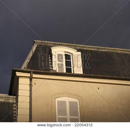 Slated Roof And Dark Sky
