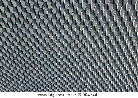 Hexagonal alloy wall pattern in horizontal 3:2 format.
