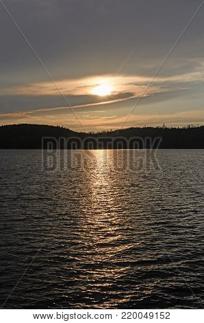 Sun Lurking behind the Clouds at Sunset on Knife Lake in the Boundary Waters in Minnesota