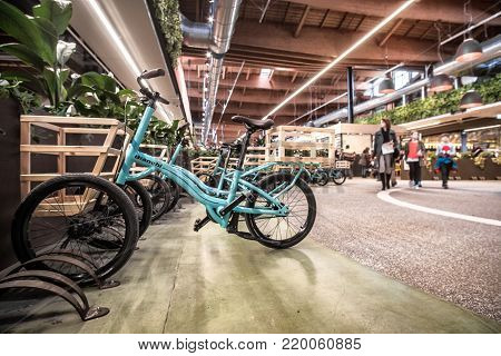 bikes are used as shopping carts inside the biggest modern italian food superstore Fico Eataly World in Bologna, Italy, 19 Nov 2017