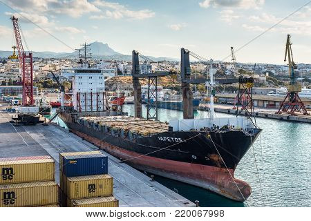 Heraklion, Greece - November 2, 2017: Container ship Iapetos awaiting loading at the port of Heraklion, Crete, Greece.