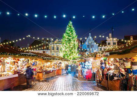 Tallinn, Estonia. Traditional Christmas Market On Town Hall Square - Raekoja Plats. Christmas Tree And Trading Houses. Happy New Year Holiday.