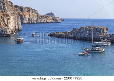 Sain Paul bay of city Lindos at iceland Rhodes with several docked boat on sea